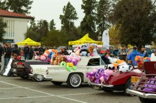 Classic cars covered with stuffed animals lined up at Motor 4 Toys at Pierce College's Parking Lot 7 in Woodland Hills, Calif. on Dec. 1, 2019. Photo by Cecilia Parada.