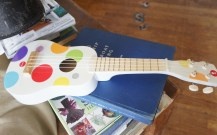 Composition: Ukelele and Puzzle Pieces