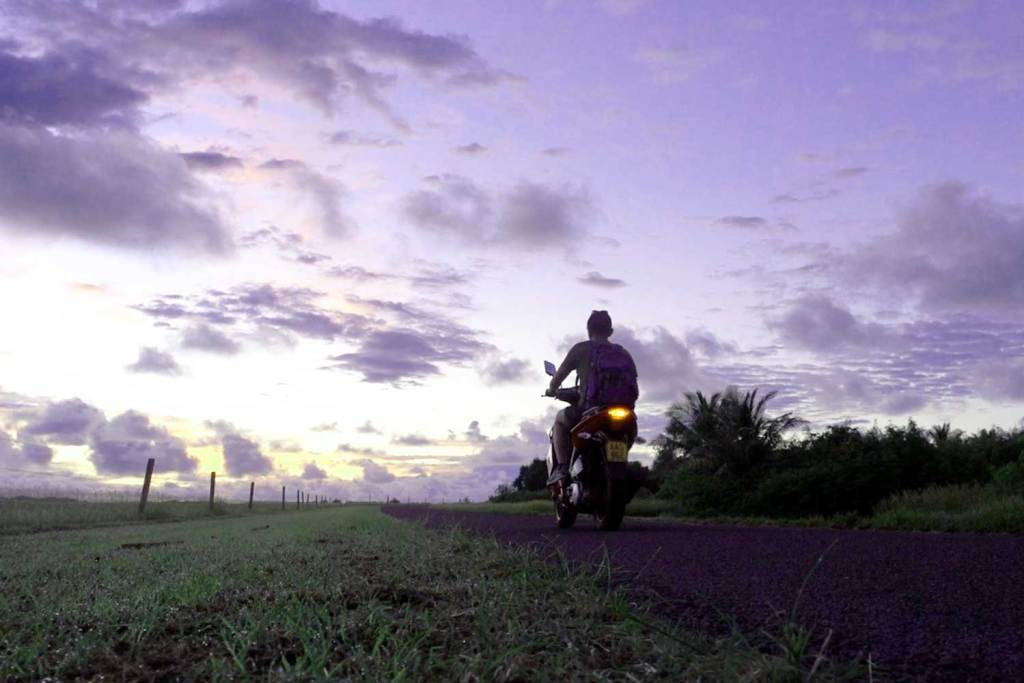halef riding a motorcycle in the Cook Islands