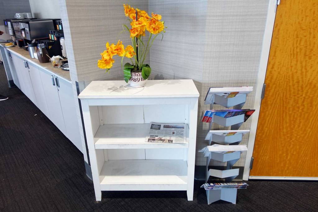 magazines in a rack with flowers