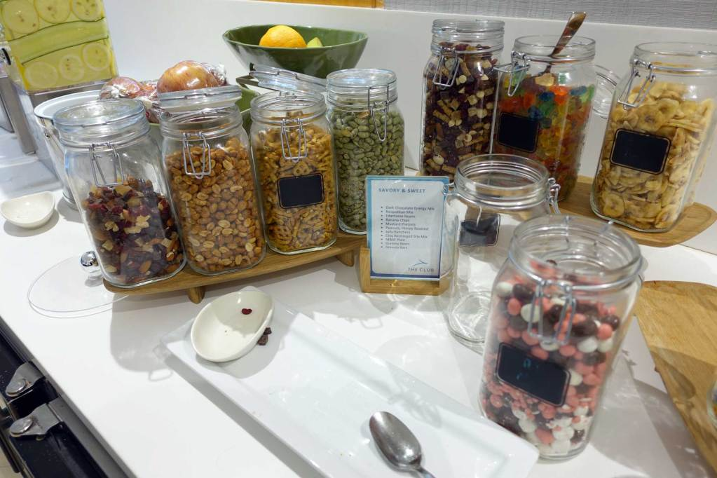 savory and sweet snacks at the lounge. trail mix, nuts, pretzels, banana chips, gummies, and more
