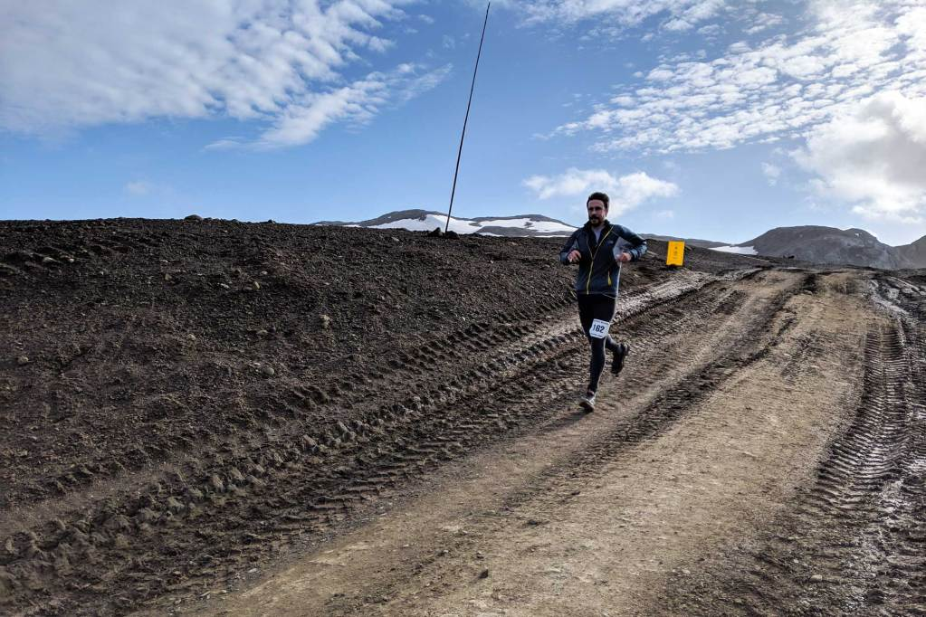 a runner on the antarctica marathon route. Picture shows deep tire and tractor treads - a hazard on the course.