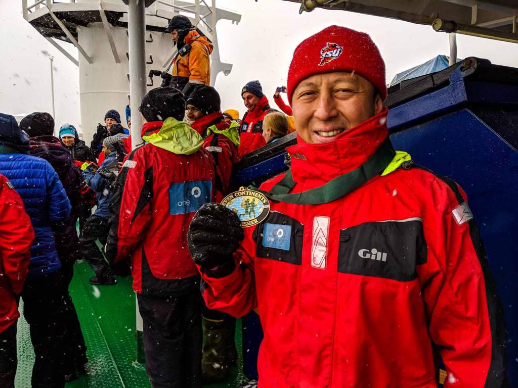 Halef showing off his Seven Continents Club medal