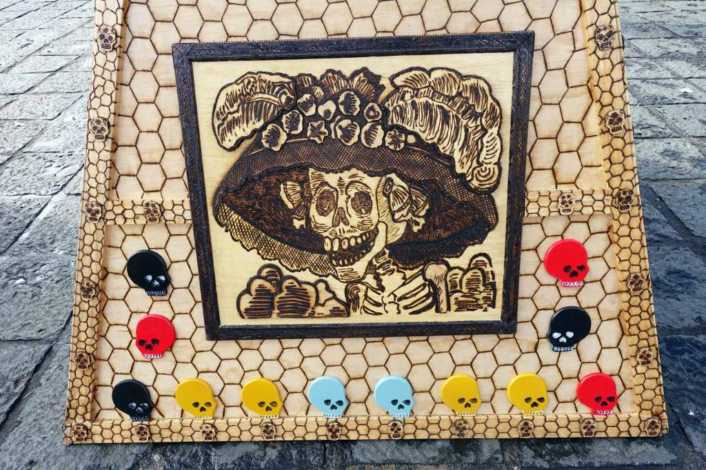 a drawing of a smiling skull in a frame