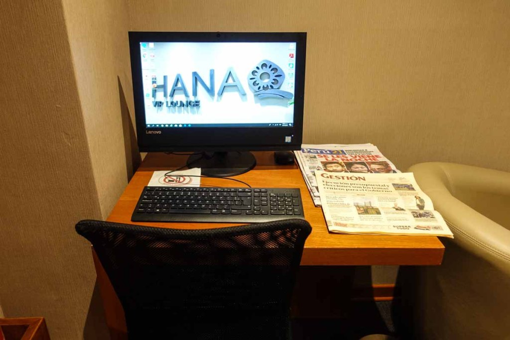 """The Hanaq VIP Lounge  """"business center"""" - aka one computer with a few newspapers strewn around it."""