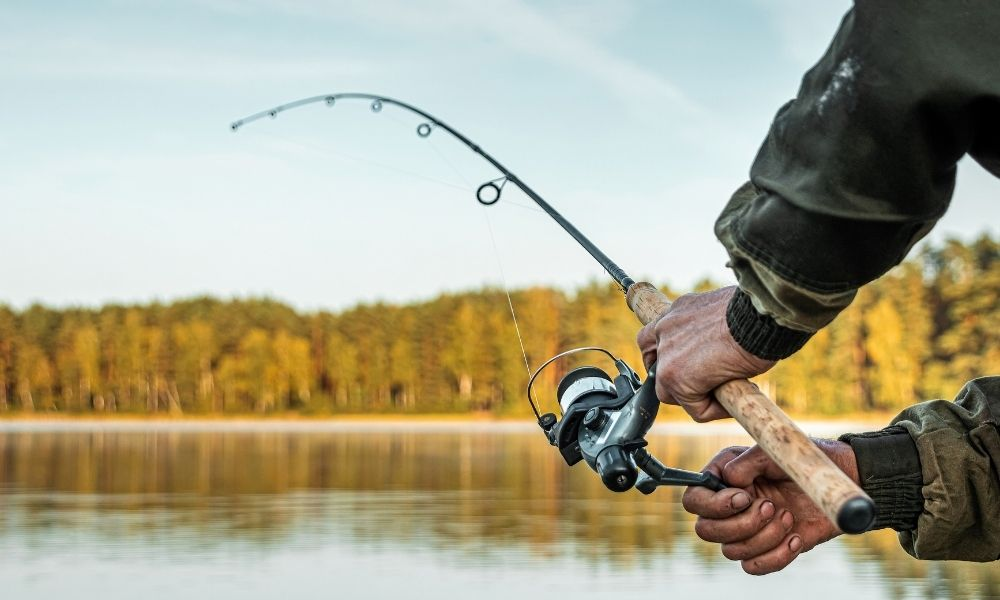 person fishing on lake