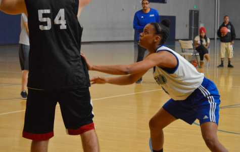 California State University, Bakersfield women's basketball team member, Lunden Reliford, keeps her gaze on the ball at practice on October 30 in the student recreation center.