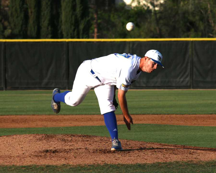 Pitcher Steven Gee throws a pitch during the game against UCSB. AJ Alvarado/The Runner