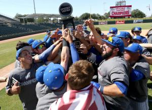 CSUB holds up its WAC Tournament Championship after the 5-4 win over Seattle on May 24. Photo by Darryl Webb/WAC