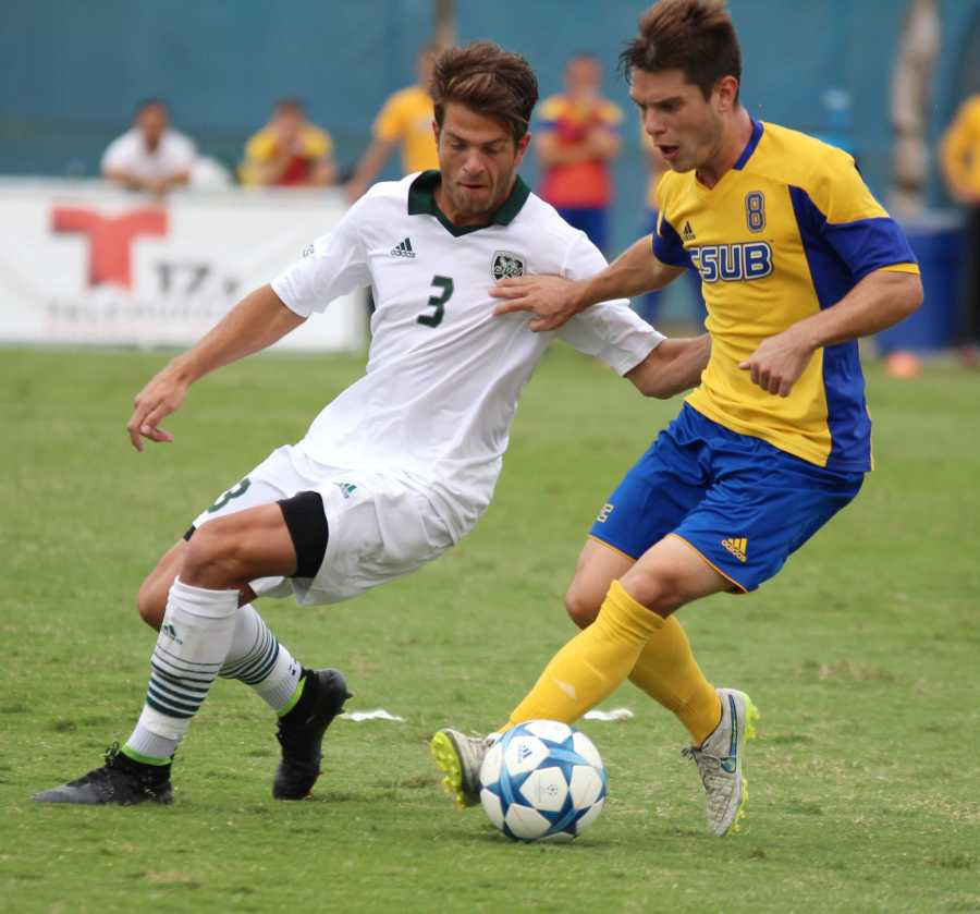 CSUB senior midfielder Christian Duarte fights to keep possession against Utah Valley sophomore midfielder Connor Salmon on Oct. 18.