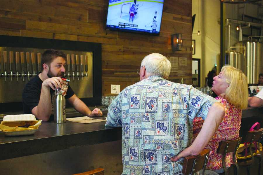 Bre Williams/ The Runner Matt Schauer talks with customers on Oct. 1 at Temblor Brewing Company. The brewery hosts live local music in addition to offering beer. The concerts are for those over 21, usually taking place on the weekends. Photo by Bre Williams/The Runner
