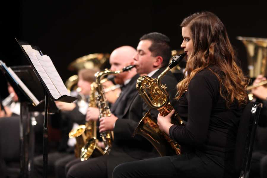 """CSUB Wind Symphony saxophone players Shaina Panga, James Russell, and Salvador Rios perform """"Variations On a Korean Folk Song"""" by John Barnes Chance during the Wind Symphony Fall Concert on Nov. 13 at the Dore Theatre."""