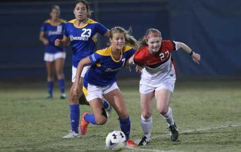 CSUB's Maja Green tries to win the ball from Seattle's senior forward Julia Moravec on Friday at the Main Soccer Field. Photo by AJ Alvarado/The Runner