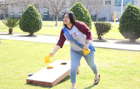 Homecoming maid nominee Melissa Lovera plays corn hole at the SRC's National Rec Day on Monday. Photo by Alejandra Flores/The Runner
