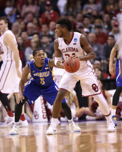 CSUB junior guard Dedrick Basile guards Oklahoma senior guard Buddy Hield during Friday's game in the Chesapeake Energy Arena. Photo by AJ Alvarado/The Runner