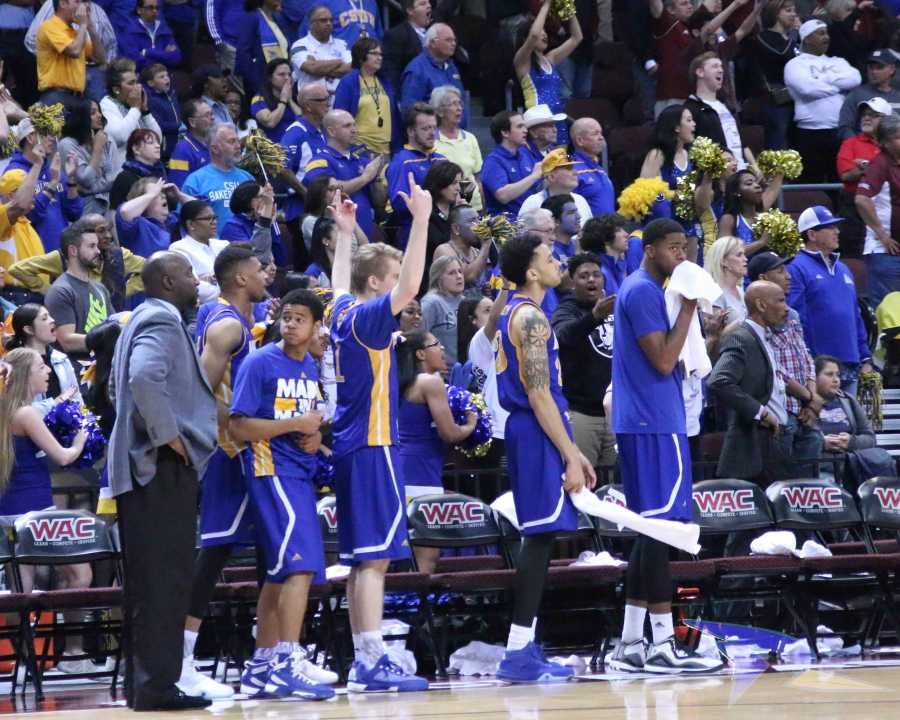 The bench celebrating after a big defensive play by the Runners.