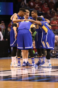 CSUB men's basketball team huddles up during the game against Oklahoma. Photo by Alejandra Flores/The Runner