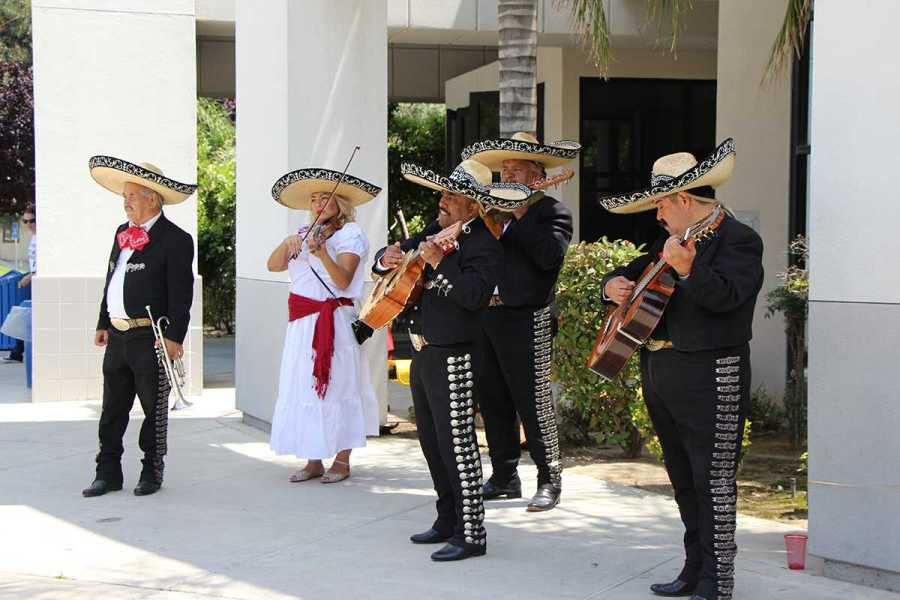 A Mexican Mariachi playing for students during Cinco de Mayo festitivies.  Photo by James Chavez/The Runner
