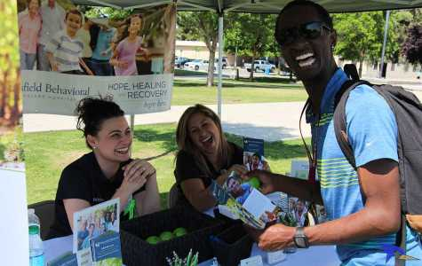 Trevante Hammonds Shad Williams having laughs with the ladies at the bakersfield hospital booth on Wednesday,  May 11 outside of the Student Union patio.