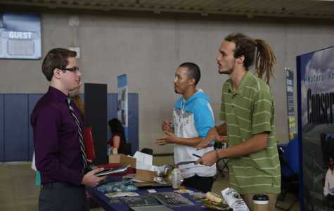 Business major Santeri Salomaki spoke to a representative from the Natural Resources Conservation Service at the fall career expo Wednesday, Oct.19 By Karina Diaz/ The Runner