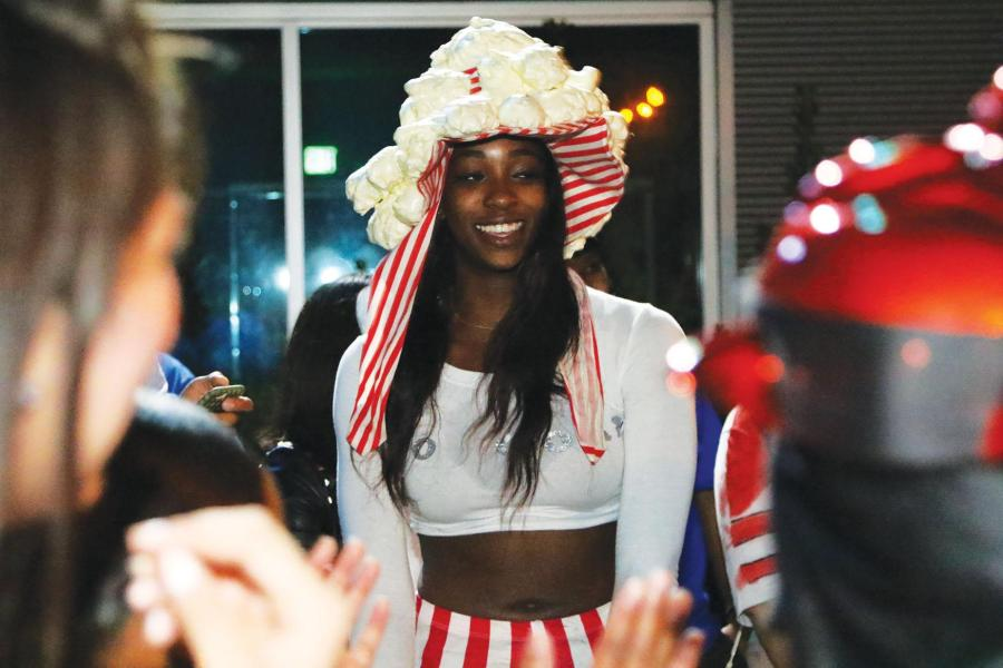 Women's basketball player Brittany Sims enjoyed activities at Runner Nights.  By Javier Valdes/ The Runner
