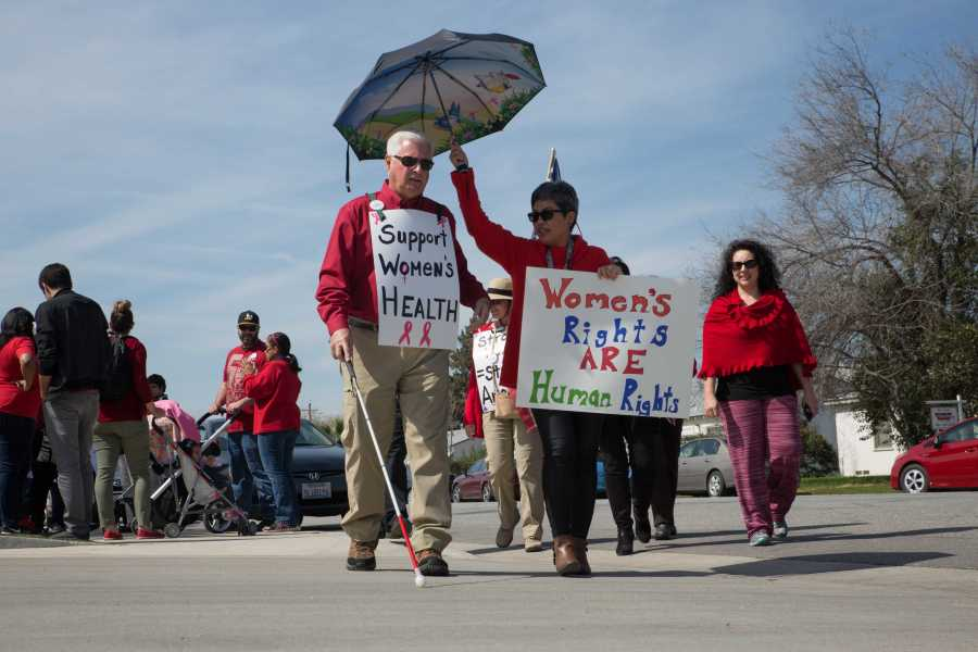 Bill Jones of Bakersfield marched in downtown Bakersfield Wednesday, March 8. Photo by AJ Alvarado/The Runner