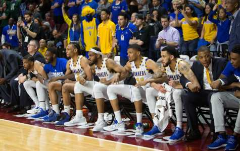 During the final seconds of the game against Utah Valley, CSUB bench holds arms as they squeak out the win and advance to the semi finals. Photo by AJ  Alvarado/ The Runner
