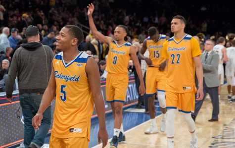 Dedrick Basile (left), Matt Smith (center), Moataz Aly (right) acknowledge the CSUB faithful as they depart from Madison Square Garden after making their historic tournament run.  Photo by AJ Alvarado/The Runner