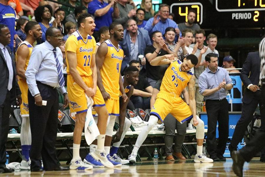 The CSUB bench celebrates during its second round victory over Colorado State University in Fort Collins, Colorado. The Roadrunners will now face the University of Texas at Arlington in the National Invitation Tournament quarterfinals Wednesday, March 22. Photo courtesy of Javon Harris/The Collegian at Colorado State University