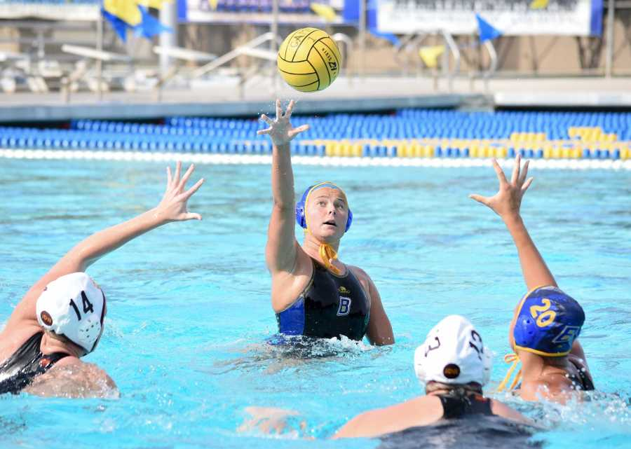 Junior year player Jada Helberg attempts to set up a teammate with a pass during a match in the 2017 season. It was the final season for water polo at CSUB. Photo by Simer Khurana/ The Runner
