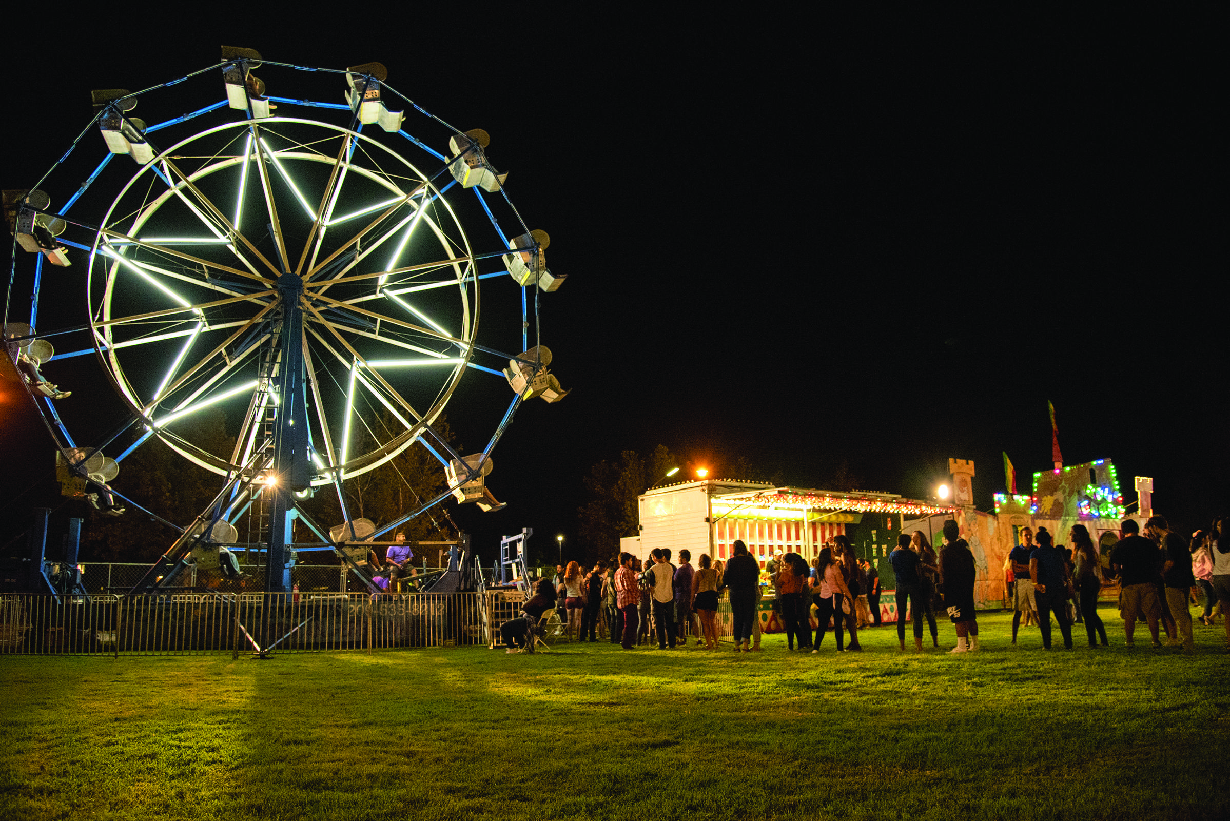 Photo by Simer Khurana/TheRunner. One of the many attractions included was the Ferris Wheel. Students were happy to line up and experience a carnival classic.
