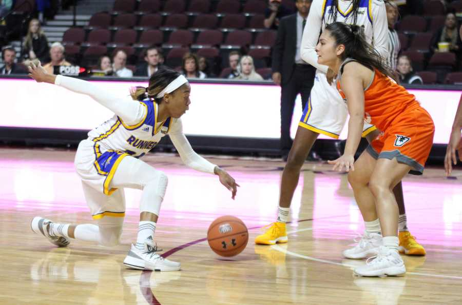Redshirt-junior guard Jazmine Johnson shows off her handles in front of a UTRGV defender in a Western Athletic Conference quarterfinals game at the Orleans Arena on Wednesday, March 7.