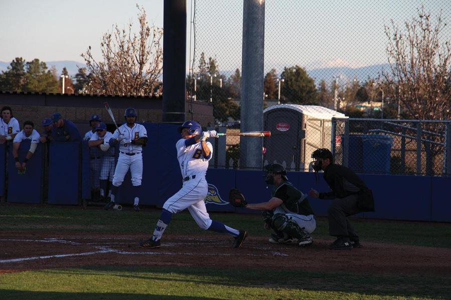 CSU Bakersfield junior catcher Ryan Koch attempts to out maneuver Dartmouth's defense early in the 1st inning.  All photos by Aaron Mills/ The Runner