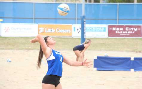 CSUB senior Aleksandra Djordjevic is seen serving to Mira Costa College on Saturday, March 10 at the Barnes Beach Volleyball Complex.  Photo by Aaron Mills/ The Runner