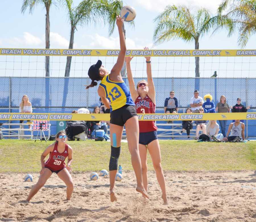 CSU Bakersfield senior Sydney Haynes goes for a kill on Saturday, March 24, at the Barnes Beach Volleyball Complex.