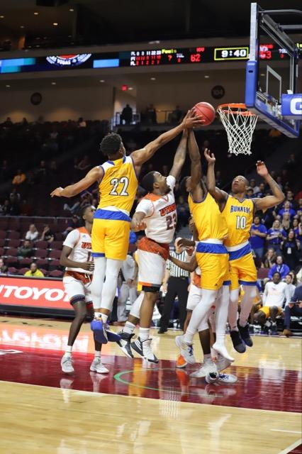 CSUB Mens basketball players Justin McCall and Justin Elder-Davis attempt to block UTRGV player at the basket