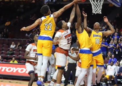 CSUB Mens basketball players Justin McCall and Justin Elder-Davis attempt to block UTRGV player at the basket