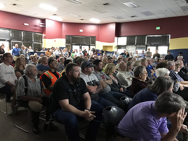 Local residents attend developer David Moons community presentation at St. Johns Lutheran Church on March 18, 2019.