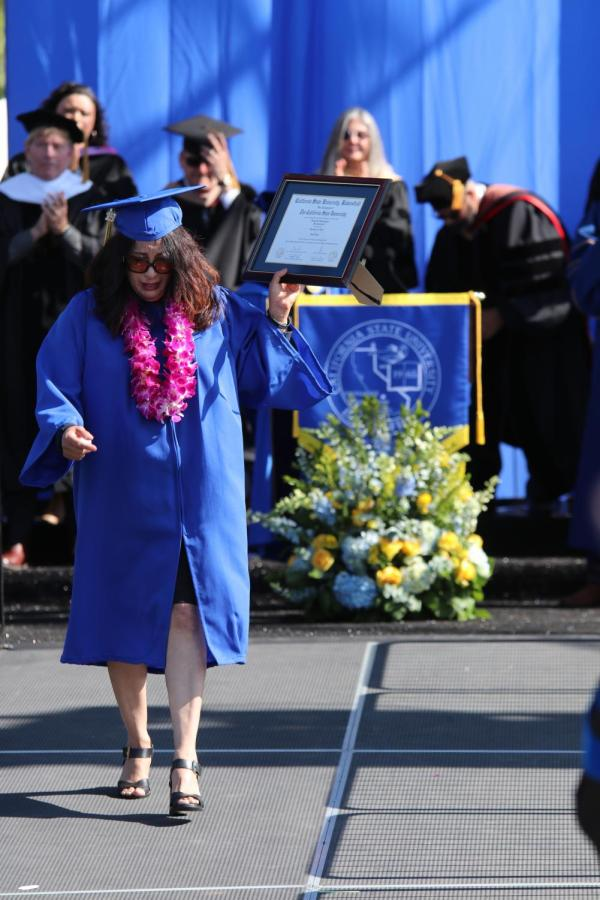 Photo+by+Sergio+Hernandez%3A+Tracy+Dominguez+accepted+her+late+daughter+Demi+Dominguez%E2%80%99s+Posthumous+Degree+during+the+Undergraduate+Ceremony+on+May+24%2C+2019.+%0A