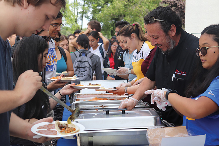 Students+being+served+tacos+in+the+Student+Union+on+Sept.+16%2C+2019.