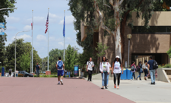 Students stroll along the red brick road at CSU Bakersfield to commence the start of Fall 2019 semester