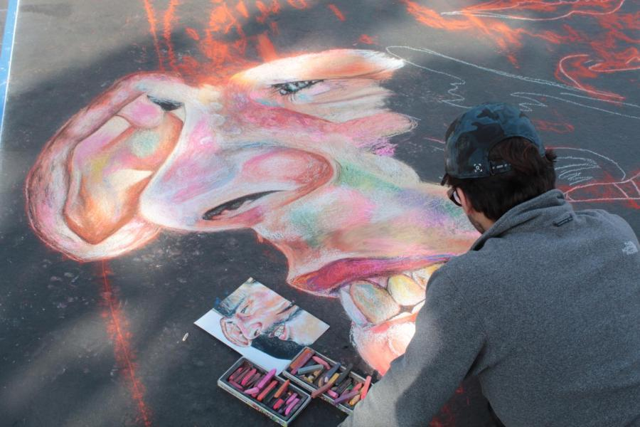 Esai Mendez, a senior studio arts major at CSUB works on his piece on Day 1 of Via Arté at the Market Place.
