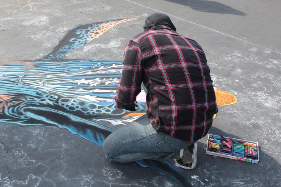 CSUB Alumni Francisco Holguin works on his piece based on the Hokuasai art movement on Day 1 of Via Arté at the Market Place.