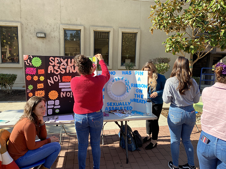 From left: Valeria Padilla and Jennifer Cano pictured setting up their poster to present to students.