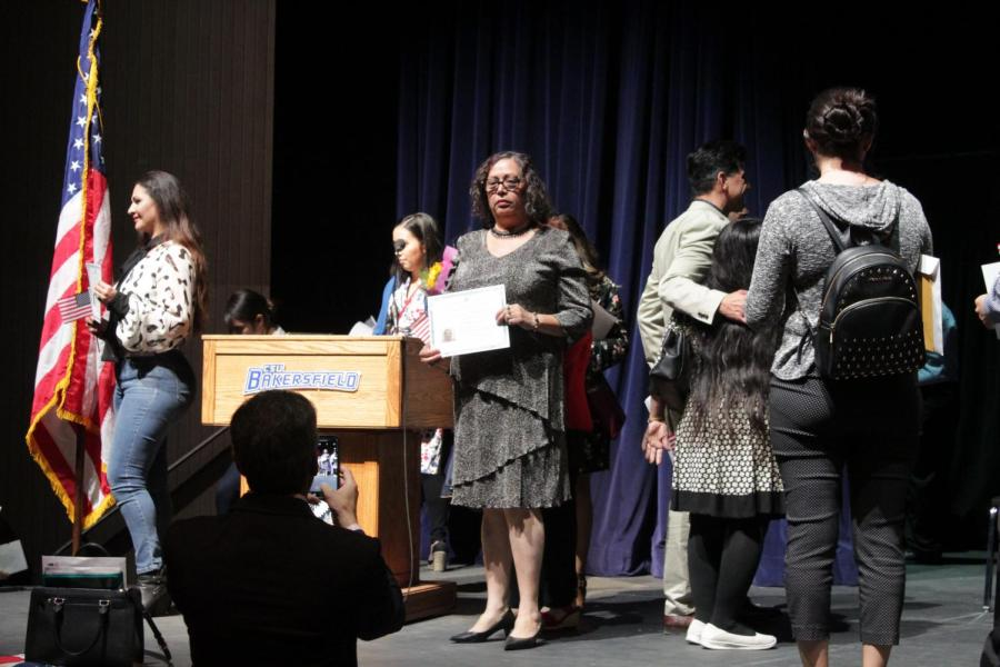 Newly naturalized valley residents pose for photographs after the Naturalization Ceremony on Nov. 12, 2019 inside Dore Theatre.