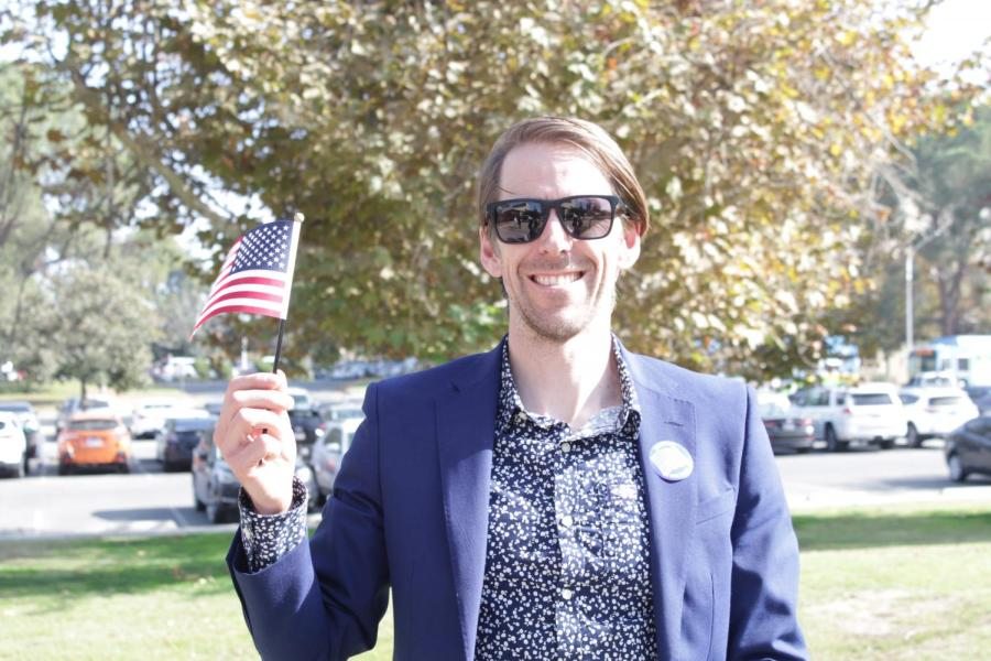 American Citizen, Simon Moore, poses with an American flag immediately after being naturalized inside the Dore Theatre during the Naturalization Event on Nov. 12, 2019.