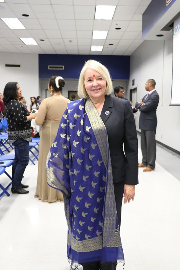 President Zelezny posed for a picture with her blue dupatta that was presented to her by Lisa Zuzarte on Oct. 29, 2019 during the ASFN Diwali Celebration. A blue dupatta is traditionally worn and has gold