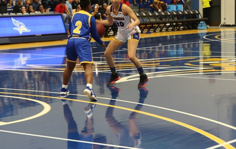 Junior guard, Kate Tokuhara, tries to dribble the basketball around Senior, Dalis Jones, during the Blue Gold event held on Tuesday Oct. 22 2019 in the Icardo Center.