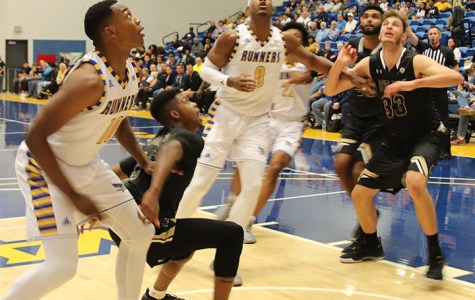 Junior Center Ronne Readus and Junior Guard Justin Edler-Davis waits for the rebound on Tuesday Nov. 5 at the Icardo Center during opening night.