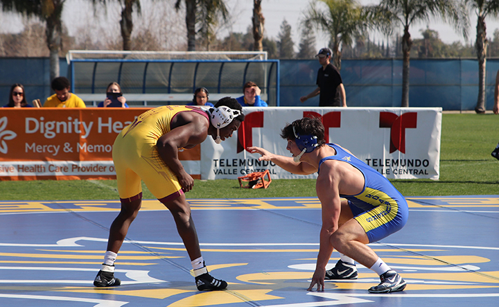 Wyatt Gerl getting ready to handle his Arizona State opponent in the CSUB Feud on The Field wrestling match versus Arizona State University held on the main field Sunday, February 16th, 2020.